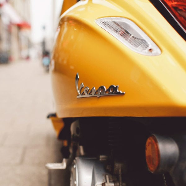 Yellow Vespa scooter on the street