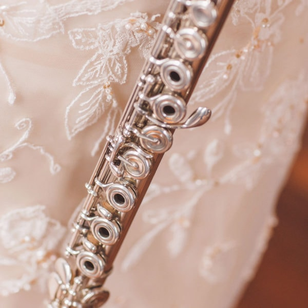 A silver transverse flute and a lace embroidered with crystals