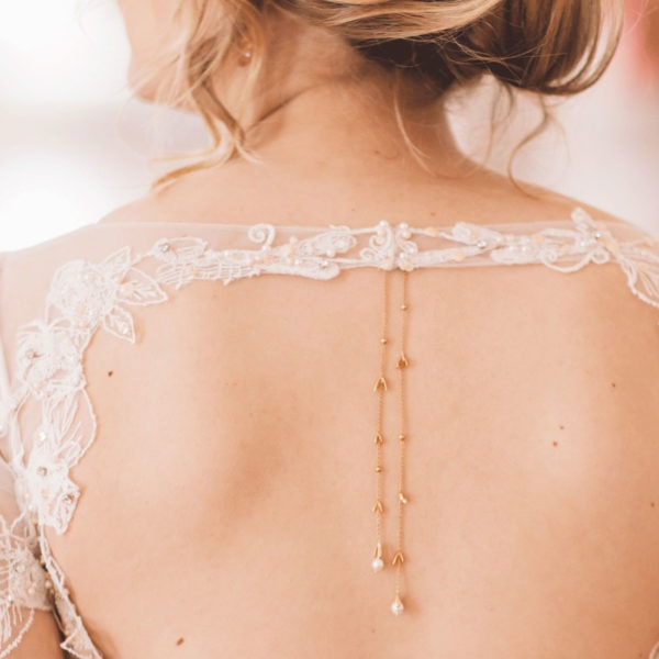 Back of an unique designed wedding dress from Truly Love Me with unique designed golden jewellery