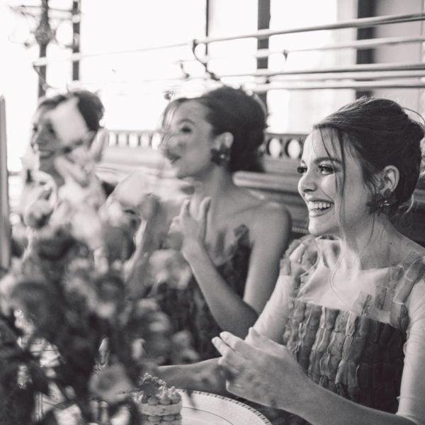 Three smiling bridesmaids in a blue sustainable designed bridesmaids dress from Truly Love Me having lunch