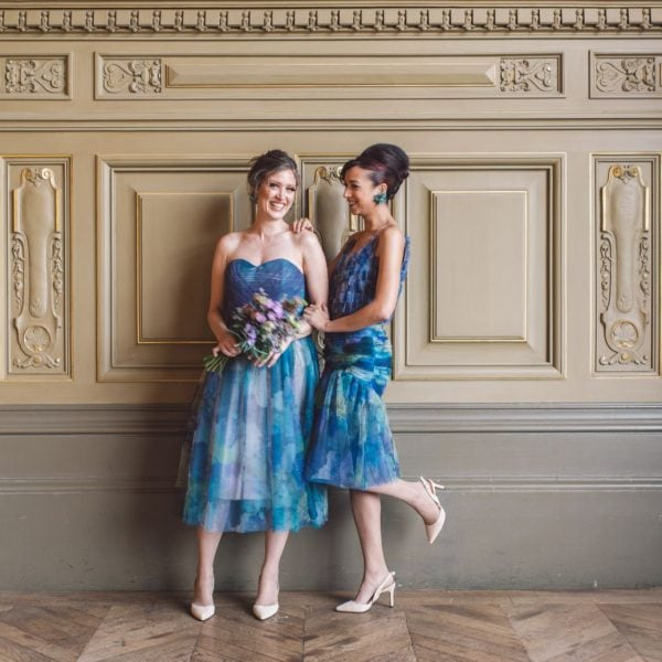 two smiling bridesmaids in Paris wearing an unique designed blue dress from Truly Love Me