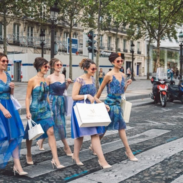 Five bridesmaids wearing unique designed blue bridesmaids dresses from Truly Love Me crossing the street in Champs-Élysées in Paris