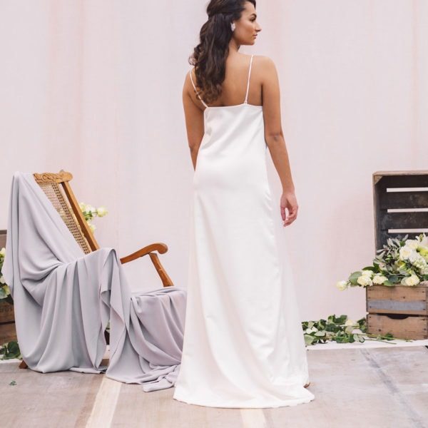 back of cultural woman wearing sustainable white satin nightgown by Maison M'Elise