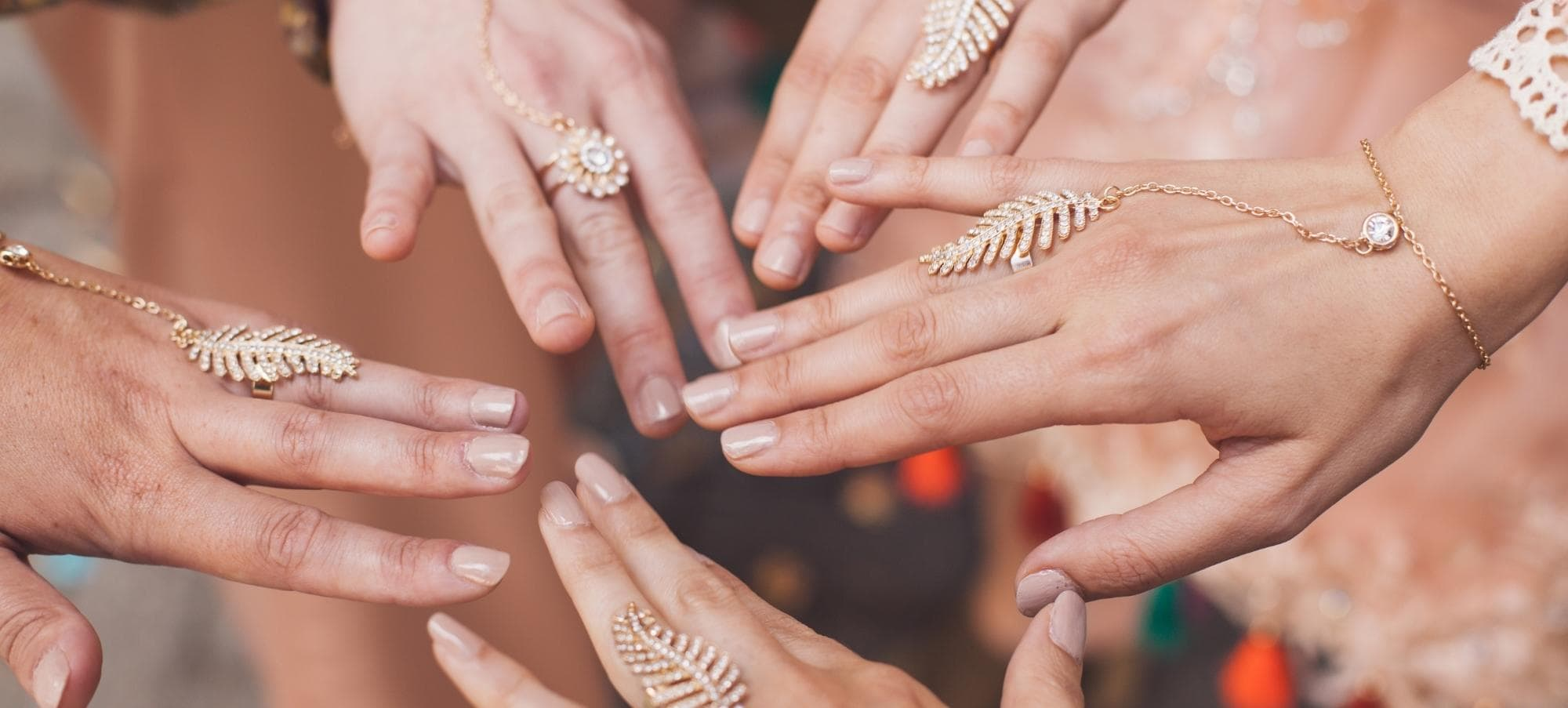 Hands from our diversity team at Maison M'Elise